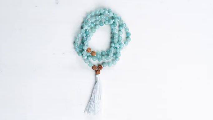 Mala made with freshwater pearls and labradorite by Kelli Davis Designs.